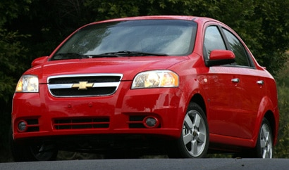 A three-quarter front view of a red 2008 Chevrolet Aveo LT