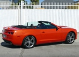 A three-quarter rear view of a  2012 Chevrolet Camaro 2SS Convertible
