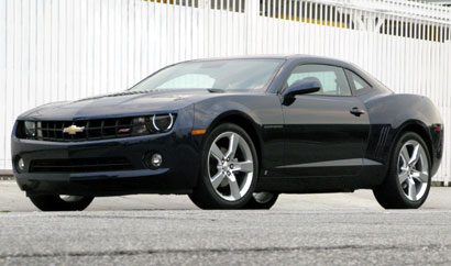 A three-quarter front view of a black 2010 Chevrolet Camaro LT