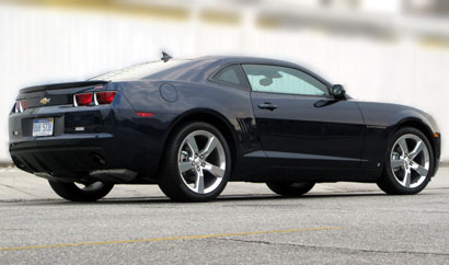 A three-quarter rear view of a black 2010 Chevrolet Camaro LT