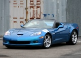A three-quarter front view of a blue 2011 Chevrolet Corvette Grand Sport Convertible