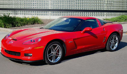 A three-quarter front view of a red 2007 Chevrolet Corvette Z06