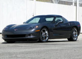 A three-quarter front view of a black 2009 Chevrolet Corvette Coupe