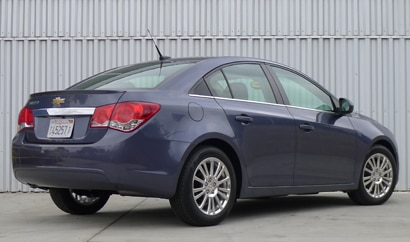 A three-quarter rear view of a 2013 Chevrolet Cruze Eco