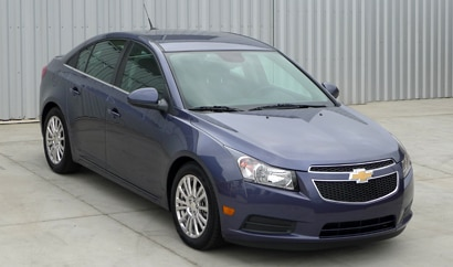 A three-quarter front view of a 2013 Chevrolet Cruze Eco