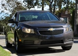 A three-quarter front view of a 2011 Chevrolet Cruze 1LT