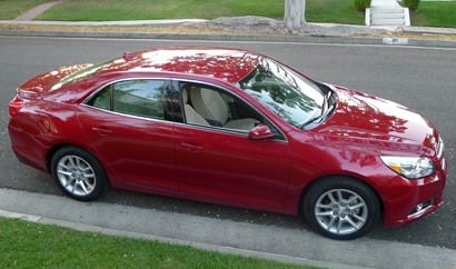 A side view of a red 2013 Chevrolet Malibu Eco