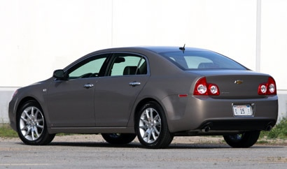 A three-quarter rear view of a dark gray 2008 Chevrolet Malibu LTZ