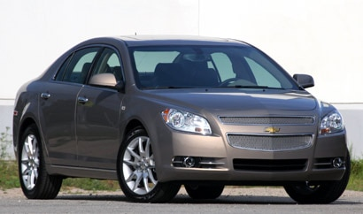 A three-quarter front view of a dark gray 2008 Chevrolet Malibu LTZ