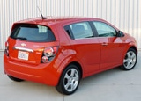 A three-quarter rear view of a 2012 Chevrolet Sonic