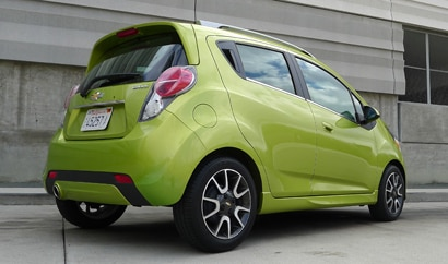A three-quarter rear view of the Chevrolet Spark