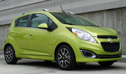 A three-quarter front view of a 2013 Chevrolet Spark