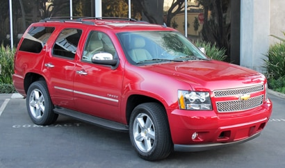 A three-quarter front view of a 2013 Chevrolet Tahoe 2WD LTZ