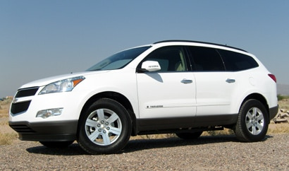 A three-quarter front view of a white 2009 Chevrolet Traverse LTZ