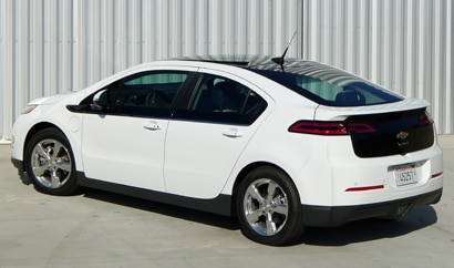 A three-quarter rear view of a white 2012 Chevrolet Volt