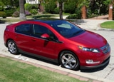 A three-quarter front view of a red 2011 Chevrolet Volt