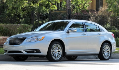 A three-quarter front view of a silver 2011 Chrysler 200