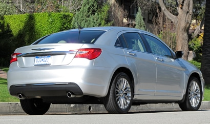 A three-quarter rear view of silver 2011 Chrysler 200