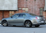 A side view of a silver 2012 Chrysler 300 SRT8