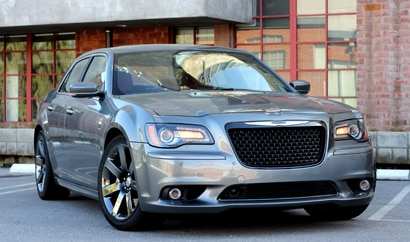 A three-quarter front view of a silver 2012 Chrysler 300 SRT8