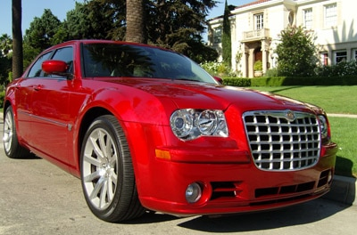 A three-quarter front view of a red Chrysler 300C SRT8