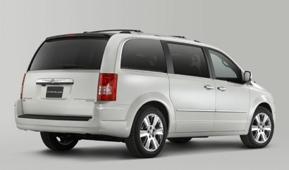 A three-quarter rear view of a white 2010 Chrysler Town & Country