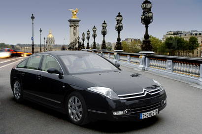 A three-quarter front view of a 2007 Citroen C6 on the streets of Paris, France