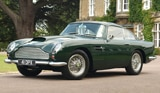 A three-quarter front view of a 1959 Aston Martin DB4GT