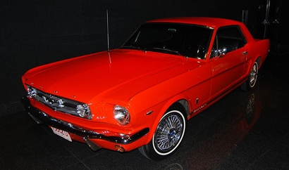 A three-quarter front view of a 1964 Ford Mustang