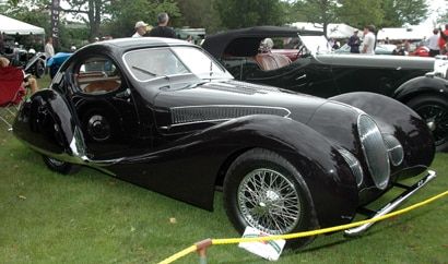 A three-quarter front view of a 1938 Talbot-Lago T150C SS