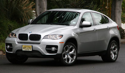 A three-quarter front view of a silver 2008 BMW X6 xDrive35i