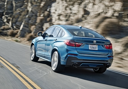 A three-quarter rear view of the 2017 BMW X4 M40i