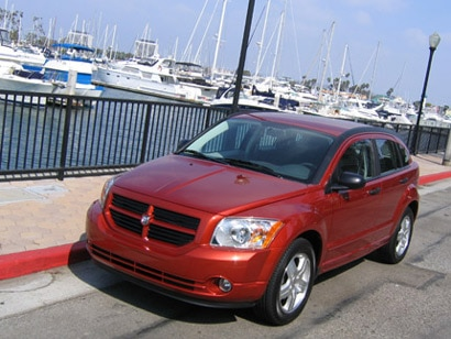 A three-quarter front view of a red 2006 Dodge Caliber SXT Sport