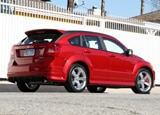 A three-quarter rear view of a red 2009 Dodge Caliber SRT4