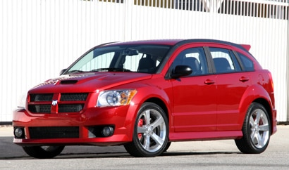 A three-quarter front view of a red 2009 Dodge Caliber SRT4
