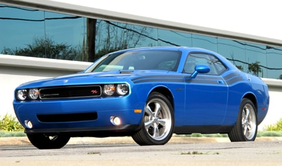 A three-quarter front view of a blue 2009 Dodge Challenger R/T