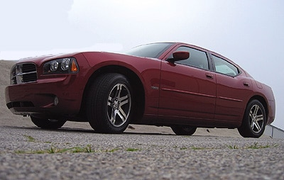 A three-quarter front view of a red 2006 Dodge Charger R/T