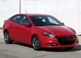 A three-quarter front view of a red 2013 Dodge Dart Rallye