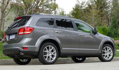 A three-quarter rear view of a 2012 Dodge Journey Crew