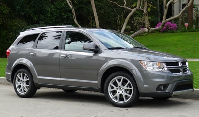 A three-quarter front view of a 2012 Dodge Journey Crew