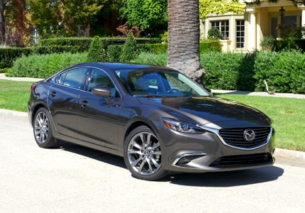 A three-quarter front view of the 2016 Mazda6 i Grand Touring sedan