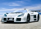 A three-quarter front view of a white Gumpert Apollo