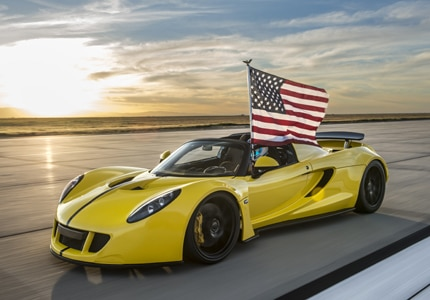 A three-quarter front view of a yellow Hennessey Venom GT