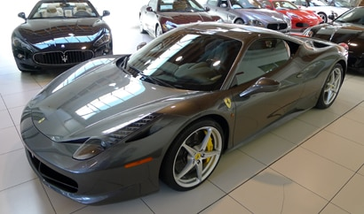A three-quarter front view of a 2012 Ferrari 458 Italia
