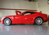 A side view of a red 2007 Ferrari 599 GTB Fiorano