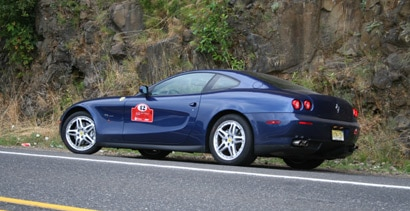 A side view of the Ferrari 612 Scaglietti on the road in Oregon
