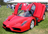 A three-quarter front view of a red Ferrari Enzo