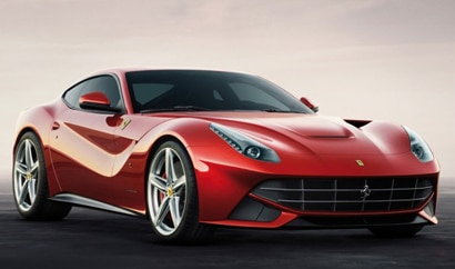 A three-quarter front view of a red 2013 Ferrari F12 Berlinetta
