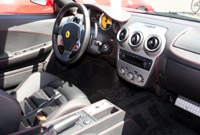 Ferrari F430 interior with black leather and red stitching