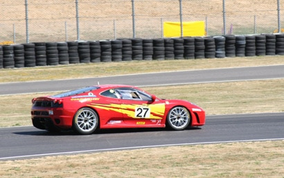 A red 2006 Ferrari F430 race car at the Ferrari Challenge Rally
